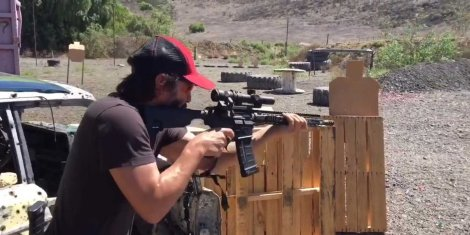 keanu-reeves-blasted-his-way-through-a-gun-range-training-for-the-john-wick-sequel.jpg